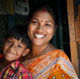 Good neighbours - Sompan with her son, Badon in Bangladesh.