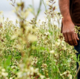 Eyan walks through a field in Gaza