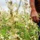 Eyan walks through a field in Gaza